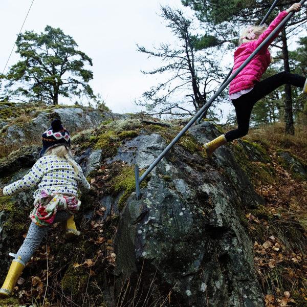 girls climbing on rock